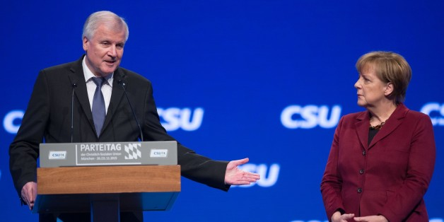 MUNICH, GERMANY - NOVEMBER 20: German Chancellor and Chairwoman of the German Christian Democrats (CDU) Angela Merkel (R) and Bavarian Governor and Chairman of the Bavarian Christian Democrats (CSU) Horst Seehofer (L) attend the annual CSU party congress in Munich, Germany on November 20, 2015. (Photo by Lukas Barth/Anadolu Agency/Getty Images)