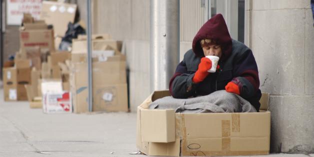 Homeless man drinking coffee