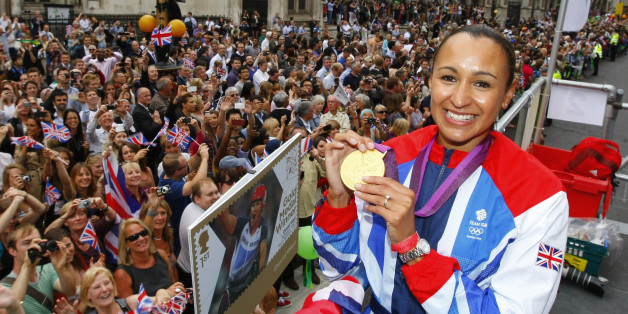 Britain's heptathlon Olympic gold medallist Jessica Ennis poses for a picture as her float passes the Royal Courts of Justice during a parade celebrating Britain's athletes who competed in the London 2012 Olympic and Paralympic Games in central London on September 10, 2012. Britain was bidding a fond farewell om September 10 to a golden summer of Olympic and Paralympic sport with a victory parade by athletes through London ending up at Buckingham Palace.