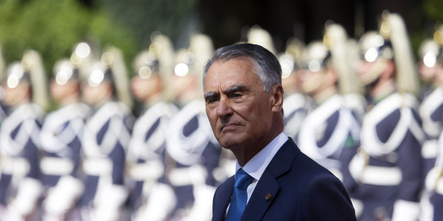 Portuguese President Anibal Cavaco Silva stands in front of a honor guard while waiting for the arrival of Senegal's President Macky Sall at the Belem presidential palace in Lisbon Tuesday, Sept. 8 2015. (AP Photo/Armando Franca)