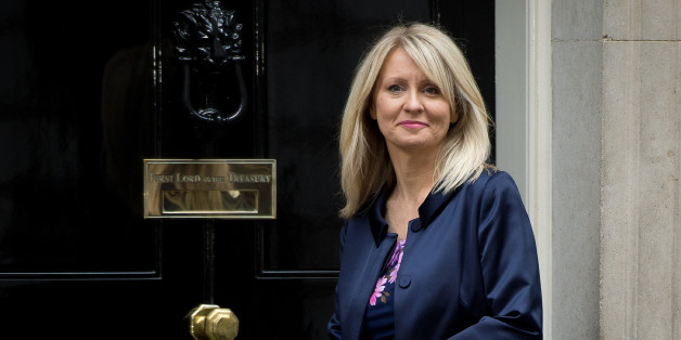 Esther McVey poses for pictures outside 10 Downing Street in London, on October 7, 2013.