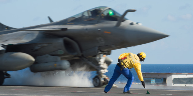 CAPTION CORRECTS THE SLUG - This photo released on Monday, Nov. 23, 2015 by the French Army Communications Audiovisual office (ECPAD) shows a French army Rafale fighter jet taking off from the deck of France's aircraft carrier Charles De Gaulle, in the Mediterranean sea. The French Defense Ministry says it has launched its first airstrikes from the aircraft carrier Charles de Gaulle, bombing Islamic State targets in the Iraqi cities of Ramadi and Mosul. (Defense Ministry/ECPAD via AP)       THIS