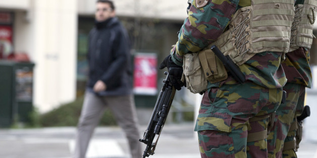 Belgian Army soldiers patrol outside EU headquarters in Brussels on Monday, Nov. 23, 2015. The Belgian capital Brussels has entered its third day of lockdown, with schools and underground transport shut and more than 1,000 security personnel deployed across the country. (AP Photo/Virginia Mayo)