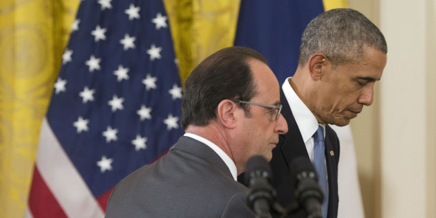 President Barack Obama and French President Francois Hollande walk off stage at the end of their news conference in the East Room of the White House in Washington, Tuesday, Nov. 24, 2015. Pledging solidarity after the Paris attacks, President Barack Obama promised Tuesday to work with France and other allies to intensify the U.S.-led campaign against the Islamic State, saying America will not be cowed by the scourge of terrorism.  (AP Photo/Pablo Martinez Monsivais)