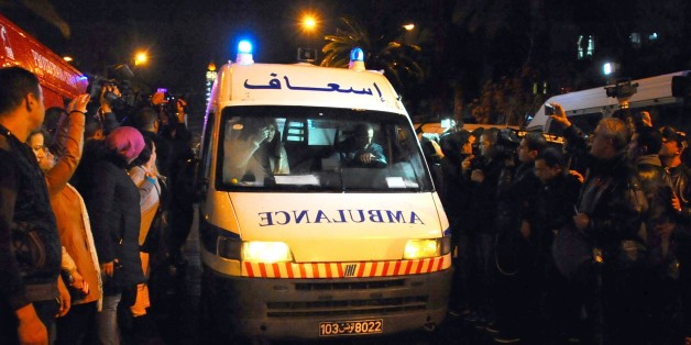 """An ambulance rushes to the scene of a bus explosion in the center of the capital, Tunis, Tunisia, Tuesday, Nov. 24, 2015. An explosion hit a bus carrying members of Tunisia's presidential guard in the country's capital Tuesday, killing at least 12 people in what the Interior Ministry called a """"terrorist act"""". (AP Photo/Hassene Dridi)"""