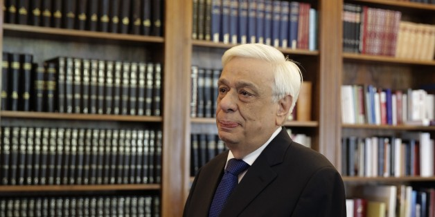 Greek President Prokopis Pavlopoulos, waits the arrival of former Energy Minister and head a party called Popular Unity , Panagiotis Lafazanis, before their meeting in Athens, Thursday, Aug. 27, 2015. Greece came one step closer to early elections Thursday as Lafazanis the head of a new breakaway left-wing party returned his mandate to form a government to the country's president after having failed to find willing coalition partners.(AP Photo/Petros Giannakouris)