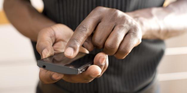 Man using smart phone