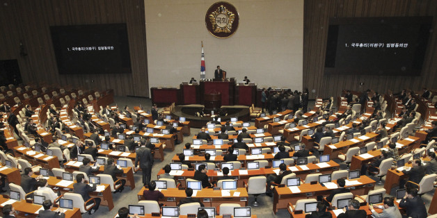 South Korean lawmakers attend to pass a confirmation of President Park Geun-hye's nomination of Lee Wan Koo as the country's prime minister during the plenary session at the National Assembly in Seoul, South Korea, Monday, Feb. 16, 2015. South Korea's ruling party-controlled legislature on Monday approved Park's choice for prime minister following fierce political wrangling over whether he's fit for the country's No. 2 job. (AP Photo/Ahn Young-joon)