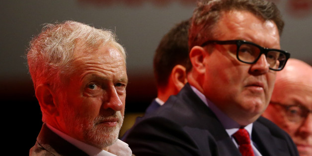 Labour party leader Jeremy Corbyn (left) with deputy leader Tom Watson listening to speeches onstage during the Labour Party annual conference at the Brighton Centre in Brighton, Sussex.