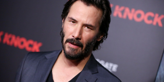 """Keanu Reeves arrives at an LA Special Screening of """"Knock Knock"""" at TCL Chinese Theatre on Wednesday, Oct. 7, 2015, in Los Angeles. (Photo by Rich Fury/Invision/AP)"""
