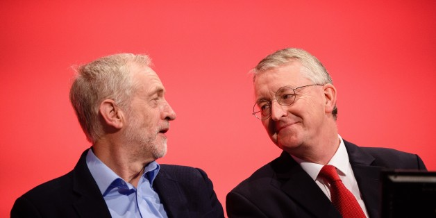 Leader of the opposition Labour Party Jeremy Corbyn (L) speaks with with Shadow Foreign Secretary Hilary Benn on day two of the annual Labour party conference in Brighton on September 28, 2015. AFP PHOTO / LEON NEAL        (Photo credit should read LEON NEAL/AFP/Getty Images)