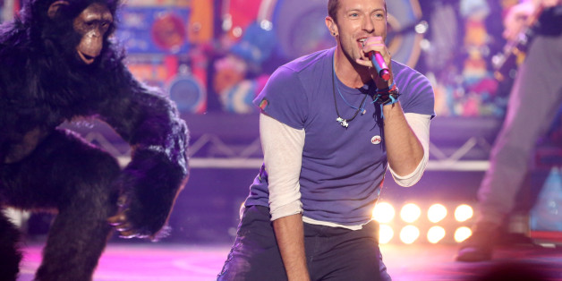 Chris Martin of Coldplay performs at the American Music Awards at the Microsoft Theater on Sunday, Nov. 22, 2015, in Los Angeles. (Photo by Matt Sayles/Invision/AP)