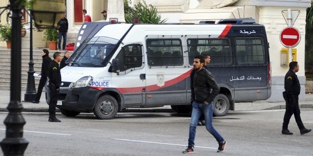 A police van parks in downtown Tunis, Thursday, Nov. 26, 2015. Tunisian authorities have identified a suicide bomber who targeted presidential guards in a deadly attack, saying he was a 27-year-old local street vendor. The Islamic State group claimed responsibility for Tuesday's attack on a bus in central Tunis, which left 12 dead plus the attacker. (AP Photo/Hassene Dridi)