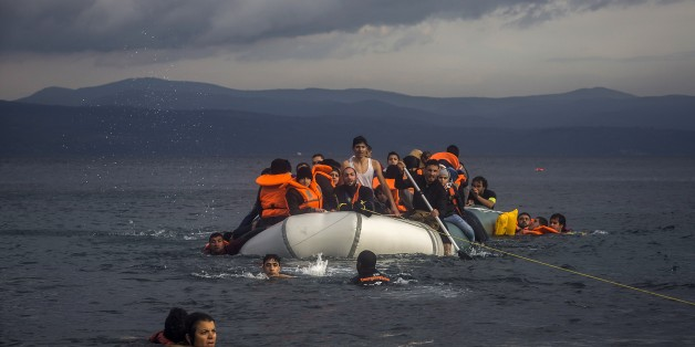 Volunteers help refugees to approach the coast after engine problems on their dinghy in the northeastern Greek island of Lesbos Wednesday, Nov. 25, 2015. About 5,000 migrants reaching Europe each day over the so-called Balkan migrant route. The refugee crisis is stoking tensions among the countries on the so-called Balkan migrant corridor — Greece, Macedonia, Serbia, Croatia and Slovenia. (AP Photo/Santi Palacios)