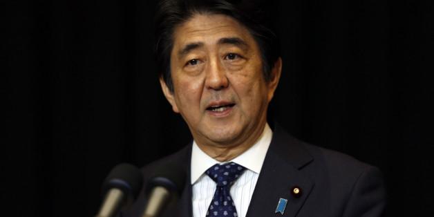 Japanese Prime Minister Shinzo Abe speaks during a press conference in Kuala Lumpur, Malaysia, Sunday, Nov. 22, 2015. (AP Photo/Lai Seng Sin)