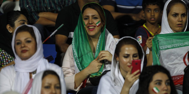 Iranian women watch the 2018 FIFA World Cup qualifying soccer match between Iran and India in Bangalore, India, Tuesday, Sept. 8, 2015. (AP Photo/Aijaz Rahi)