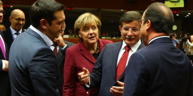 BRUSSELS, BELGIUM - NOVEMBER 29: Prime Minister of Greece Alexis Tsipras (L), Chancellor of Germany Angela Merkel (2nd L), Turkish Prime Minister Ahmet Davutoglu (2nd R) and President of France Francois Hollande (R) attend EU summit meeting in Brussels, Belgium on November 29, 2015. (Photo by Hakan Goktepe/Anadolu Agency/Getty Images)