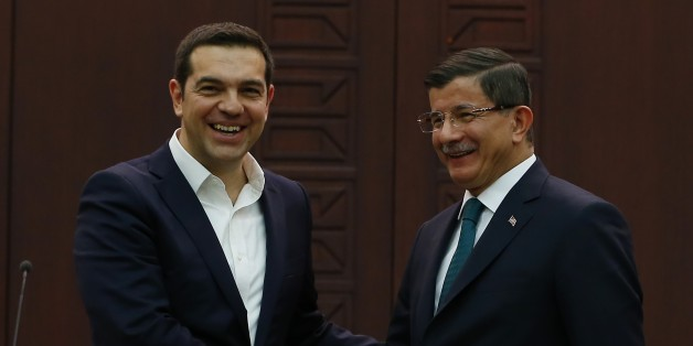 ANKARA, TURKEY - NOVEMBER 18: Turkish Prime Minister Ahmet Davutoglu (R) and his Greek counterpart Alexis Tsipras (L) shake hands following a press conference at the Cankaya palace in Ankara, Turkey on November 18, 2015. (Photo by Murat Kaynak/Anadolu Agency/Getty Images)