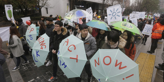 Environmental activists march during the Global Climate March in Seoul, South Korea, Sunday, Nov. 29, 2015. The march is part of a global campaign ahead of next week's U.N. climate talks in Paris. (AP Photo/Ahn Young-joon)