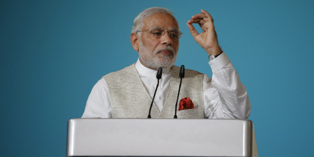 Indian Prime Minister Narendra Modi delivers the 37th Singapore Lecture Monday, Nov. 23, 2015, in Singapore as he starts his two-day official visit to the city-state. (AP Photo/Wong Maye-E)