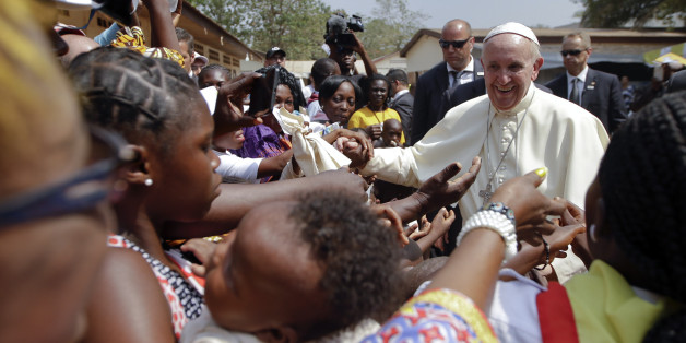 Pope Francis is cheered by locals as he visits a refugee camp, in Bangui, Central African Republic, Sunday, Nov. 29, 2015. The Pope has landed in the capital of Central African Republic, his final stop in Africa and where he will seek to heal a country wracked by conflict between Muslims and Christians. (AP Photo/Andrew Medichini)