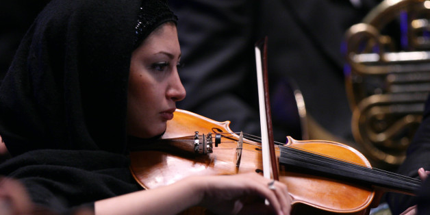 A member of Tehran Symphony Orchestra plays during Asian Mayors Forum in Tehran on Wednesday Oct, 19, 2008.(AP photo/Hasan Sarbakhshian)