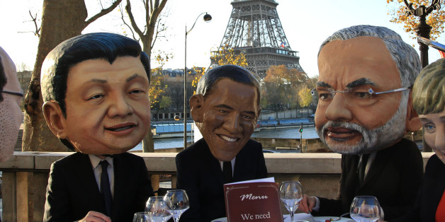 Oxfam activists wear masks  from left, of French President Francois Hollande, Chinese President Xi Jinping, U.S. President Barack Obama, India's Prime Minister Narendra Modi and German Chancellor Angela Merkel as they stage a protest ahead of the 2015 Paris Climate Conference, in Paris, Saturday, Nov. 28, 2015. Oxfam wants world leaders to get the best climate deal for poor people. (AP Photo/Thibault Camus)