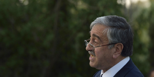 Turkish Cypriot leader Mustafa Akinci speaks during an event where he and Cyprus' president Nicos Anastasiades shared their respective visions for a Cyprus after a settlement inside the UN controlled buffer zone that divides the Cypriot capital, in Nicosia, Wednesday, July 8, 2015.  Cyprus President Nicos Anastasiades and Turkish Cypriot leader Mustafa Akinci met during a special bi-communal event in the capital Nicosia organised by the respective Chambers of Commerce and Industry of both communities.(AP Photo/Pavlos Vrionides)