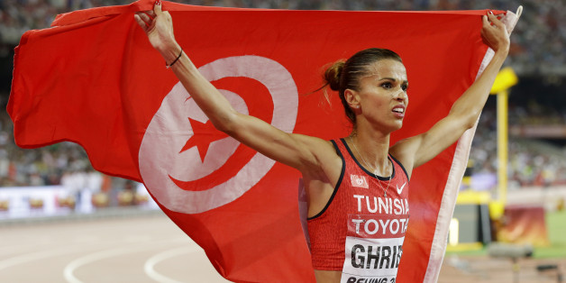 Tunisia's Habiba Ghribi celebrates after winning a silver medal in the women's 3000m steeplechase final at the  World Athletics Championships at the Bird's Nest stadium in Beijing, Wednesday, Aug. 26, 2015. (AP Photo/Kin Cheung)