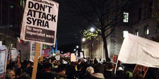 Thousands of people protest against military intervention in Syria near Parliament Square in London.