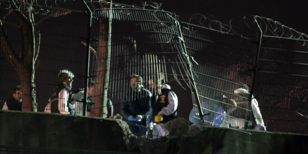 Police forensic officers investigate after an explosion on a highway overpass near a subway station wounded five people and was caused by a bomb, in Istanbul, Turkey, Tuesday, Dec. 1, 2015. The bomb was left on barriers on the overpass, said Atilla Aydiner, the mayor for Istanbul's Bayrampasa district.(AP Photo/Can Erok)