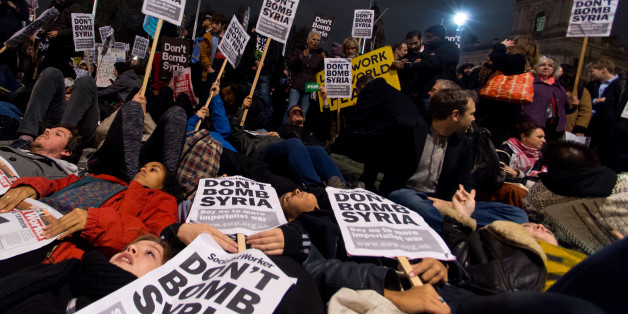 Protesters participate in a 'Die In' protest in Parliament Square