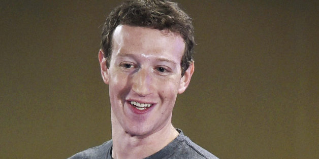 Facebook CEO Mark Zuckerberg interacts with technology students in a town hall-style meeting in New Delhi, India, Wednesday, Oct. 28, 2015. Zuckerberg defended his company's contentious efforts to expand Internet access in the developing world during his second visit to India this year. (Shirish Shete/Press Trust of India via AP) INDIA OUT