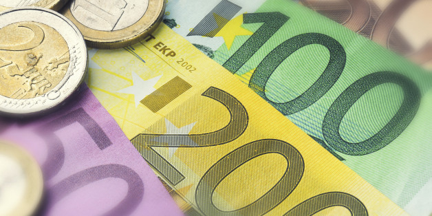 Euro banknotes and coins. Finance concept