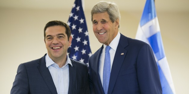 US Secretary of State John Kerry (R) and Greek Prime Minister Alexis Tsipras pose for the media at the United Nations headquarters in New York on September 30, 2015. AFP PHOTO/Dominick Reuter        (Photo credit should read DOMINICK REUTER/AFP/Getty Images)