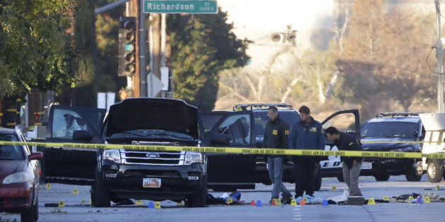 Authorities investigate the scene where a police shootout with suspects took place, Thursday, Dec. 3, 2015, in San Bernardino, Calif.  A heavily armed man and woman opened fire Wednesday on a holiday banquet, killing multiple people and seriously wounding others in a precision assault, authorities said. Hours later, they died in a shootout with police.  (AP Photo/Jae C. Hong)