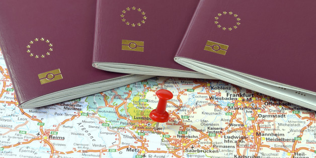Schengen on the map marked with a red a pin and EU passports
