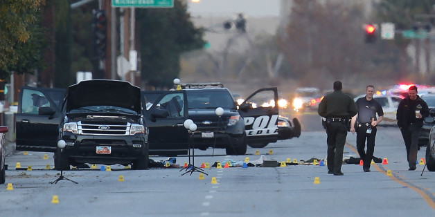 SAN BERNARDINO, CA - DECEMBER 04:  Law enforcement officials continue their investigation around the Ford SUV vehicle that was the scene where suspects of the shooting at the Inland Regional Center were killed on December 4, 2015 in San Bernardino, California. Police continue to investigate a mass shooting at the Inland Regional Center in San Bernardino that left at least 14 people dead and another 17 injured on December 2nd.  (Photo by Joe Raedle/Getty Images)