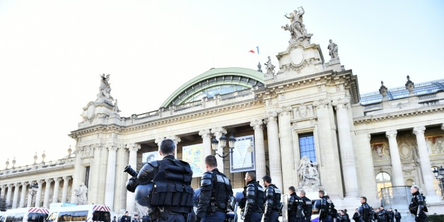 French police forces stand in front of the 'Solutions COP21' exhibition at the Grand Palais in Paris  after a demonstration on December 4, 2015 as  part of the COP 21, the United Nations conference on climate change. More than 150 world leaders are meeting under heightened security, for the 21st Session of the Conference of the Parties to the United Nations Framework Convention on Climate Change COP21/CMP11) from November 30 to December 11.  / AFP / LOIC VENANCE        (Photo credit should read LOIC VENANCE/AFP/Getty Images)