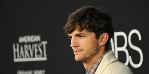 """Ashton Kutcher arrives at the special screening of """"Jobs"""" at the Regal Cinemas L.A. Live on Tuesday, Aug. 13, 2013, in Los Angeles. (Photo by Jordan Strauss/Invision/AP)"""