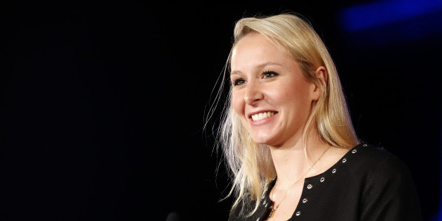 Far right National Front party regional leader for southeastern France, Marion Marechal Le Pen, is seen during a meeting in Nice, southeastern France , Friday, Nov.27,2015. Regional elections are taking place next month in which the far right National Front is hoping to increase its political power, in part by capitalizing on tensions over waves of migrants in Europe this year. The first round of the regional elections will take place on Dec. 6, 2015. (AP Photo/Lionel Cironneau)
