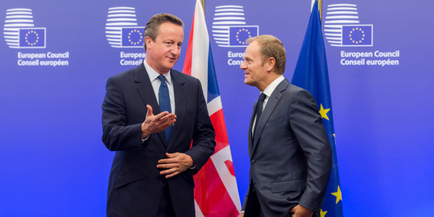 European Council President Donald Tusk, right, welcomes British Prime Minister David Cameron upon his arrival at the EU Council building in Brussels on Thursday, Sept. 24, 2015. (AP Photo/Geert Vanden Wijngaert)