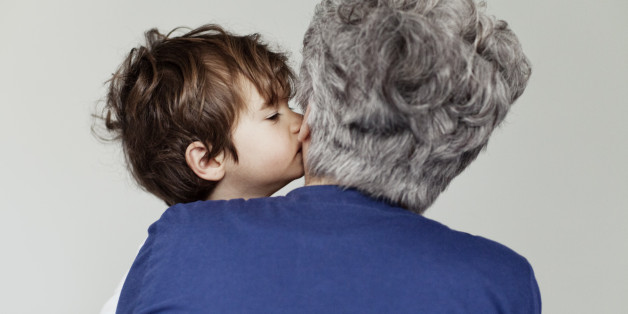 Small boy kissing his grandmother
