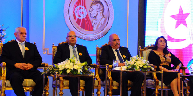 Wided Bouchamaoui president of the Tunisian employers, right, Abdessattar Ben Moussa, president of the Tunisian Human Rights League, second right, Mohamed Fadhel Mafoudh head of the Tunisian Bar Association and Houcine Abassi secretary general of the Tunisian General Labour Union, left, attend a ceremony in Tunis Monday, Nov.9, 2015. The 2015 Nobel Peace Prize went to the Tunisian National Dialogue Quartet who steered Tunisia away from civil war and toward democracy after its 2011 revolution. (A
