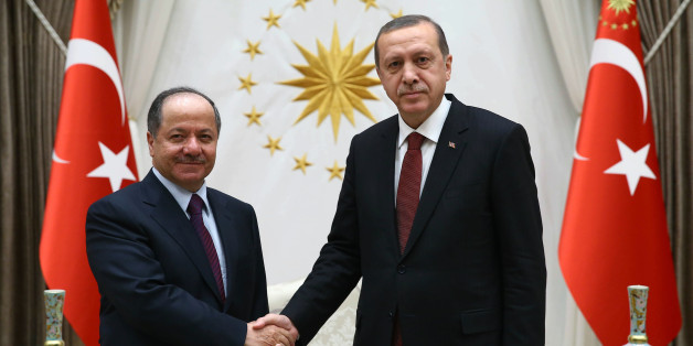 """Turkish President Recep Tayyip Erdogan, right, and President of Iraq'a northern Kurdish region, Massoud Barzani, shake hands before a meeting in Ankara, Turkey, Wednesday, Dec. 9, 2015. Turkish Prime Minister Ahmet Davutoglu on Wednesday defended his country's deployment of additional forces to Iraq last week, saying it was an """"act of solidarity"""" with Iraq's fight against the Islamic State group. Turkey has stationed troops at a base outside of the Iraqi city of Mosul since last year as part of a training mission coordinated with the Iraqi government in Baghdad. (AP Photo/Yasin Bulbul, Presidential Press Service, Pool )"""