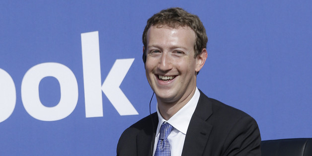 Facebook CEO Mark Zuckerberg smiles while speaking at Facebook in Menlo Park, Calif., Sunday, Sept. 27, 2015. A rare visit by Indian Prime Minister Narendra Modi this weekend has captivated his extensive fan club in the area and commanded the attention of major U.S. technology companies eager to extend their reach into a promising overseas market. (AP Photo/Jeff Chiu)