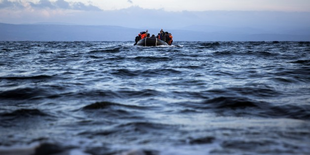Migrants and refugees approach on a dinghy the northeastern Greek island of Lesbos from the Turkish coast, on Wednesday, Dec. 9, 2015. Greek authorities say in another incident at the southeastern Greek islet of Farmakonissi at least 12 people have died and 26 are missing after a boat carrying about 50 migrants sank in Aegean Sea. (AP Photo/Santi Palacios)