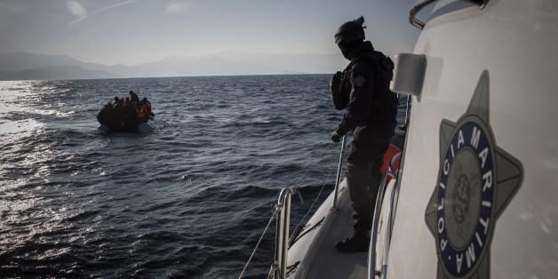 Members of the Frontex, European Border Protection Agency, from Portugal approach a dingy with 56 people, who were lost in an open sea as they try to get to the Greek island of Lesbos, Tuesday, Dec. 8, 2015. In another incident six children have drowned after a rubber dinghy carrying Afghan migrants to Greece sank off Turkey's Aegean coast. Turkey has stepped up efforts to stop migrants from leaving to Greece by sea. (AP Photo/Santi Palacios)