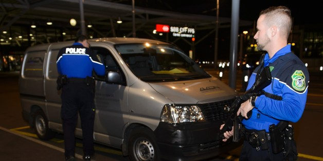 Security forces stop a van at the check vehicles arriving at Geneva's airoport on December 10, 2015, after police raised the alert level and searched the city for several suspected jihadists believed to have links to the Islamic State (IS) group, security sources said. Security services in the Canton of Geneva said they received information on December 9 from Swiss federal authorities about suspicious individuals in the Geneva area. The Tribune de Geneve, in an unconfirmed report, said the intel