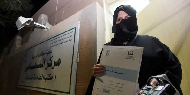 Aljazi al-Hussaini, a candidate for the municipal council in the town of Diriyah, on the outskirts of the Saudi capital Riyadh, shows an electoral campaign license issued by the central municipal elections committee on November 29, 2015. Women in Saudi Arabia begin their first-ever electoral campaign on November 29, a step forward for both womens rights and the kingdoms slow democratic process. Hundreds of Saudi women began campaigning for public office, in a first for women in the conservative Muslim kingdom's slow reform process even as two activists were disqualified. AFP PHOTO / FAYEZ NURELDINE / AFP / FAYEZ NURELDINE        (Photo credit should read FAYEZ NURELDINE/AFP/Getty Images)